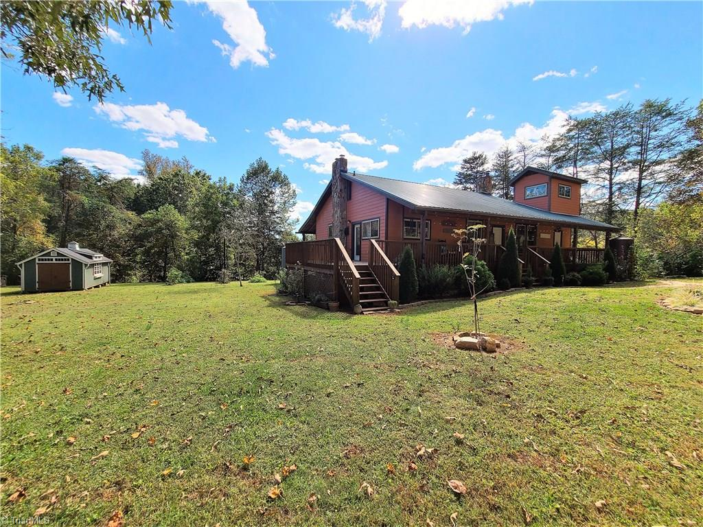 Unique home with over 9 acres bordering Snow Creek. Property has fencing for animals, buildings including small goat shelters, run ins and large storage building.  Home was originally built as a preppers type home and has been converted to a more modern type function but still has many unique features like wood flues in many rooms in the home, cubby type beds built in and a rain water catch system. Home has oversized living room, 2 bedrooms on the main, fully finished basement with in law suite and bonus room that could be bedroom or den.  Land has lots of fencing, many garden areas and perfect country get away or live simply off the land.  HOme also has a kitchen area on the basement level also. Absolutely perfect if you want to go off the grid and go back to a simpler time. Property has a 5,000 gallon rain catch system, very neat bunk house style room accessed from the porch and just an array of  unique features.  This is a must see!