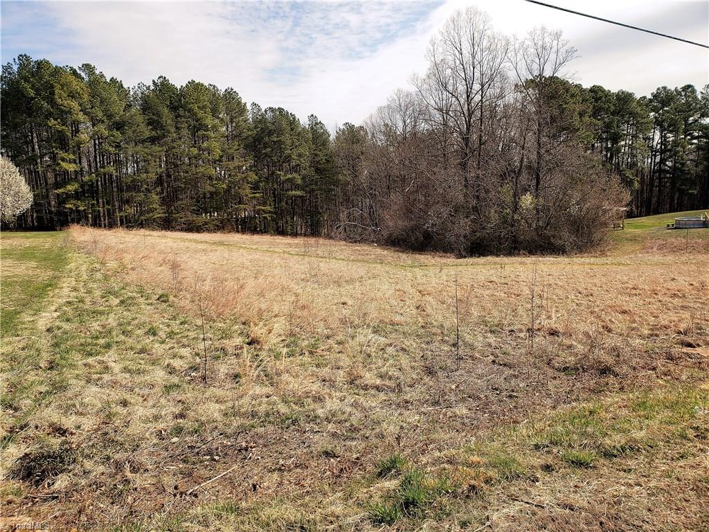Great location close to Hwy 66 and convenient to town.  Over an acre and half  already clear and ready for your custom built home! Public water available. Lot rolls nicely and would be perfect for basement home. Lot is not in neighborhood and is in line with other custom homes. Lot has been approved for a 3br drip system septic.  Price reduced to sell!