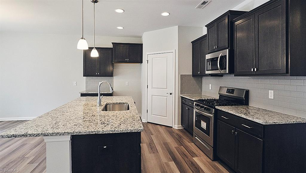 Soft close Kitchen cabinets, Open Rail on main and second floor Additional concrete patio pad French doors on Flex room/Office