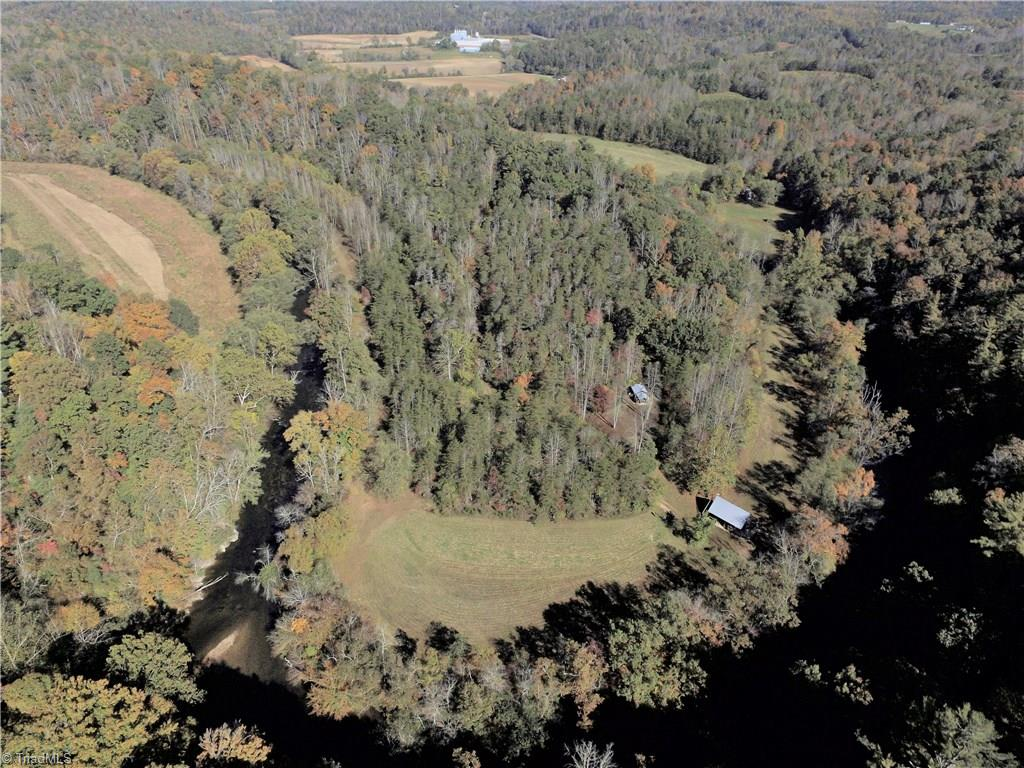 26 acre Island oasis on the Dan River! This is a property like you will not find very often anywhere!  Over 26 acres nearly surrounded by the Dan with 4400 of footage on the river.  Property boasts large shelter building with a bunkhouse in the top of the building for your overnight stays on the river, , tractor shed with rustic shower outside with tankless water heater, shelter also has storage and other camping type set up.  Property also has many cleared areas with easy access to the river and trails throughout the property.  Check out the drone video and just imagine getting away from the real world for as long as you like!