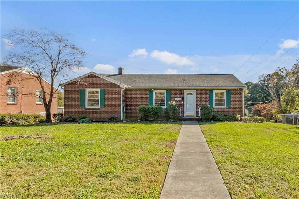 Solidly built and well maintained all brick rancher located minutes from medical centers, major highways, schools, and shopping.   Light and bright with fresh paint and vinyl replacement windows.  Wood floors ready for your choice of color and finish.  There is a lovely eat-in kitchen and a vent-less gas fireplace in the den.  The level, partially fenced back yard provides space to play and a large sunny garden box.  A full lower level offers room to add a den/man cave along with the 1 car garage, work space and huge storage area.  There is also a covered and secure space for a 2nd car in the detached carport.  A WHOLE HOUSE AUTO-START GENERATOR ensures you will never lose power in a storm or bad weather.  Make your appointment today!
