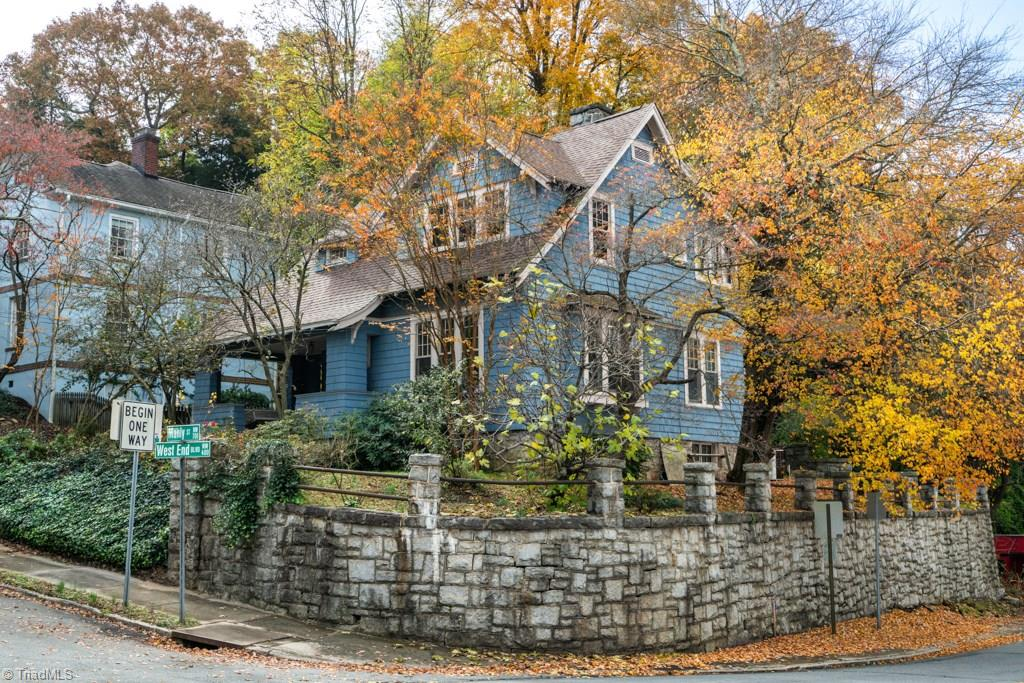 Gorgeous house that is located on a corner lot in Winston Salem! This house features a unique stone wall wrapping the entire property! This home is full of potential with amazing hard wood floors! Don't miss out on this wonderful home!