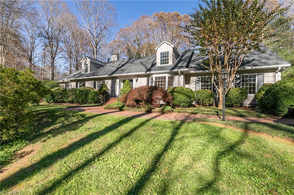 Fabulous offering on private setting of 1.86 acres in the city!  Large rooms for entertaining, hardwood floors, two fireplaces.  Main level master bedroom with updated bath plus main floor guest room/office/nursery.  Incredible brick patio with built-in grill and water feature.  Two-car detached garage with plenty of storage, one-car attached garage.  Walk-in storage.  Won't last long!