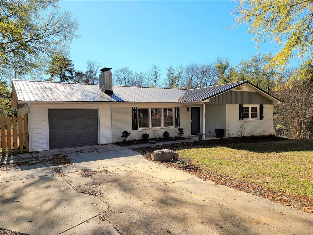 Spectacularly updated 3 bedroom/2 bath brick ranch!  Home has insulated windows, Granite counter tops, Tile flooring in the kitchen and bathrooms, laminate wood through out the rest of the main level, updated paint, 50 year baked tin roof, finished basement with den, office area and exercise area, basement storage area with basement garage and oversized covered deck built for entertaining or just relaxing.  Beautiful home convenient to town and shopping.