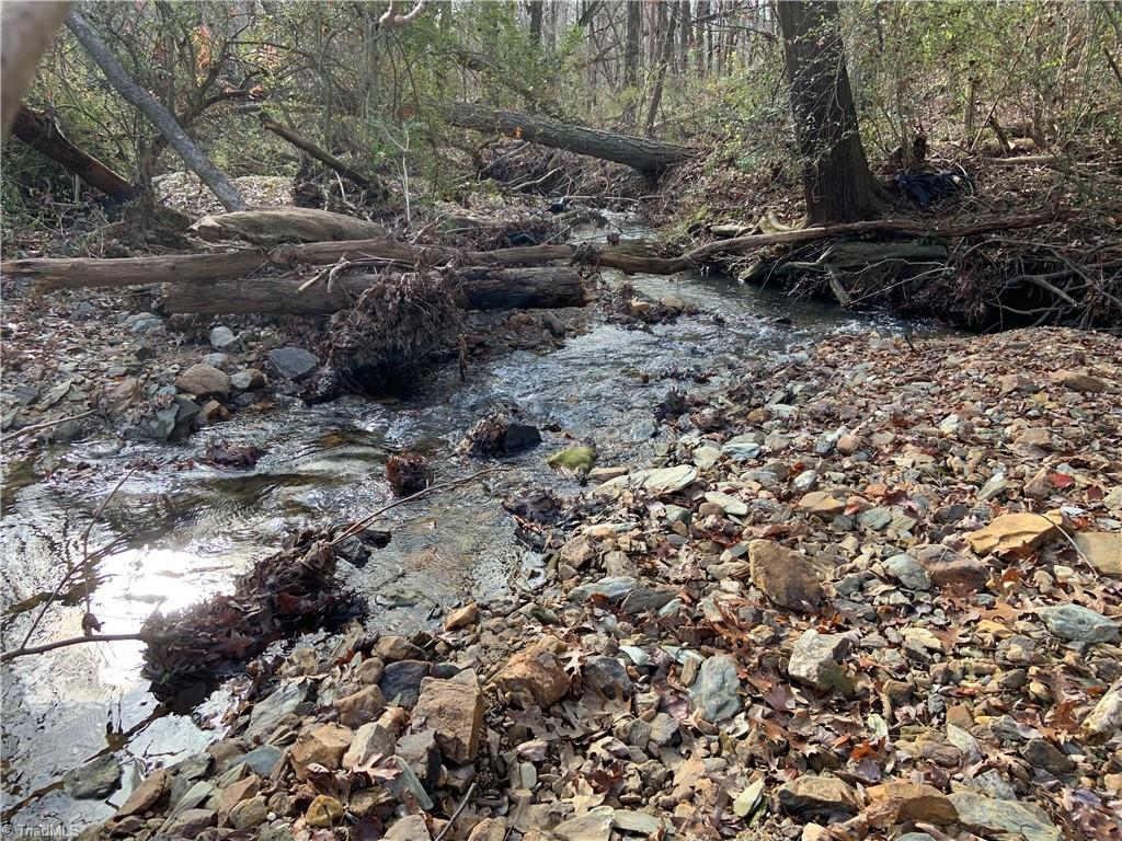 2.62 wooded acres with creek frontage. Build cabin or hunt the land. Can be purchased with 004636 cabin with 3.3 acres. You will need high clearance vehicle Howards Way is a farm road.