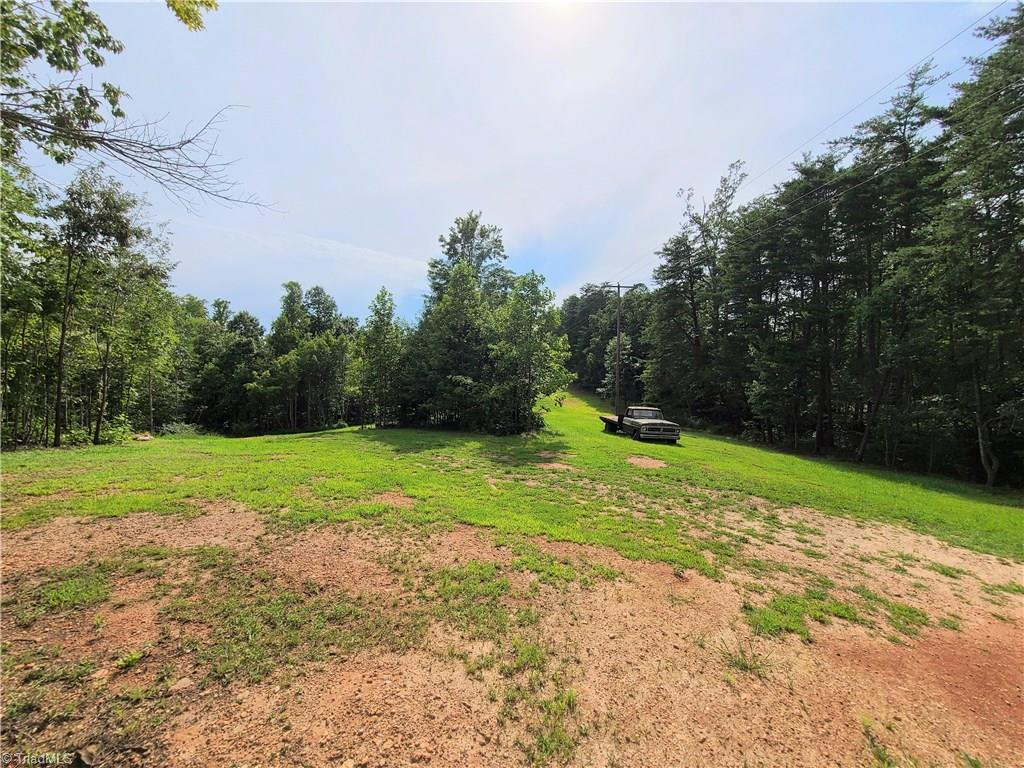 Over 10 acres with cleared home site at 2 spots.  Views of Sauratown Mountain and possibly Pilot Mountain.  Property is perfect for a custom home with a view.  Property is also gated.  Come on out to the peace and serenity of the country! 11 acre parcel adjoining available also. Check out the drone fly over link on the virtual tour tab.