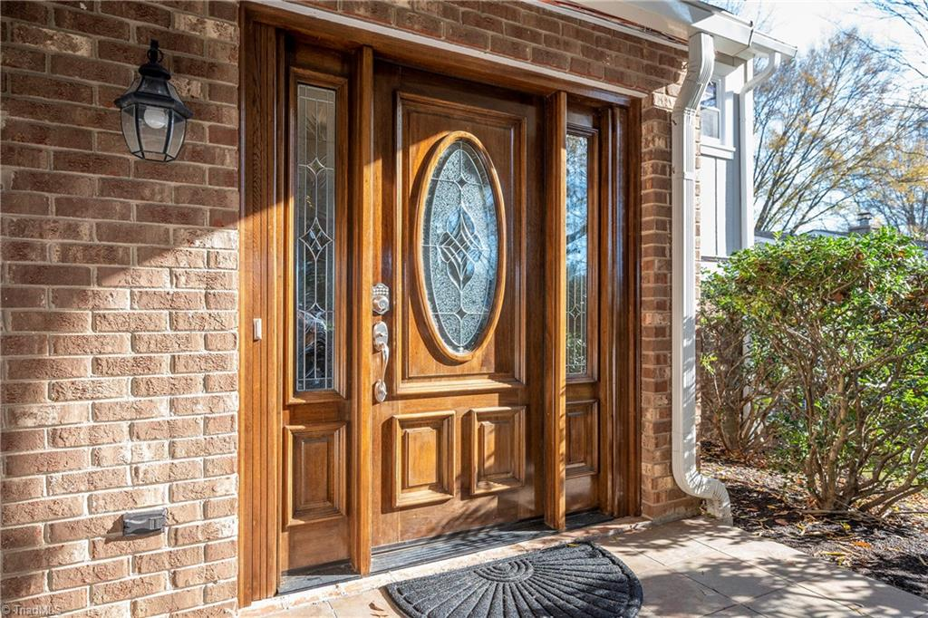Privacy & Security! Gated Community, Lake views. Gorgeous 3 BR 2.5 Bath townhome remodeled in 2015 adding 600+ sq ft (450 sq ft heated and 150 sq ft 3 season room) a total of 2,900+ sf under roof! This home Features a Delightful Great Rm w/ fireplace, dedicated space for wet bar/wine Rm, Pool Table Rm, 3 Season Rm w/ Sauna & huge Bonus Rm upstairs w/ 180 degree views of ponds & so much more! Large kitchen w/ granite countertops, great cabinet space, SS appliances & formal dining Rm. Large Master Bedroom suite w/ gym area, walk-in closet & updated bathroom. Includes a 2 car attached carport! BRCC membership NOT required. Pool, tennis and golf w/OPTIONAL country club membership. Additional update list available upon request.