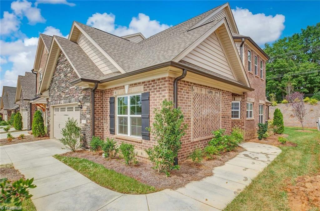 Live at our beautiful upscale town home community at Friedberg Villages. Enjoy the conveniences of living close to the city with LOW Davidson County taxes. 3BR, 3BA, Sunroom, Loft & 2-car garage, brand new, brick/stone luxury town home. Master suite/Sunroom/Guest Bedroom on main level. Loft, 3rd BR/Office, full bath and 2 walk-out attic storage areas upstairs. Luxury Vinyl Plank flooring throughout downstairs. Granite countertops in kitchen and all baths. White cabinetry. Master bath has a 5' tile shower with bench seat and frameless door, raised height dual vanity with granite countertop and rectangular sinks, water closet, large walk-in closet and luxury vinyl plank flooring. Stone surround, two-sided fp. This home backs up to woods. **PICTURES ARE SIMILAR TO HOME BEING BUILT**