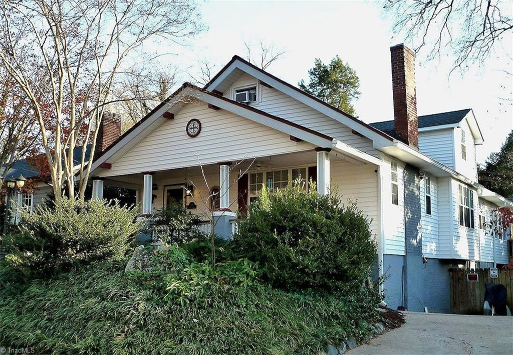 Charming well-maintained 1910 bungalow in historic Washington Park neighborhood, ½ block from playground, dog park, greenway access. Approx. 2,275 sq.ft. plus 258 sq.ft. exercise room. Shady front porch, enclosed screened back porch, covered deck, and level, fenced back yard for relaxed outdoor enjoyment. 1st floor rooms have 9-ft. ceilings and heart pine or ceramic floors. Open, flowing layout includes living room w/gas fireplace, dining room w/bar sink & breakfast bar, large kitchen w/updated appliances, and half bath. Master bedroom opens to walk-in closet/laundry room and large full bath with double sinks, steam shower, & jetted tub. Bedroom is currently used as a media room. 2nd floor has another spacious master with full bath, walk-in attic access, and third bedroom. Lower level has finished exercise room with hot tub & heat/AC. Walk-in basement. Modern wiring, plumbing, windows, and insul. New roof 2017. Low-maintenance landscape. Perennial and organic gardens in back yard.