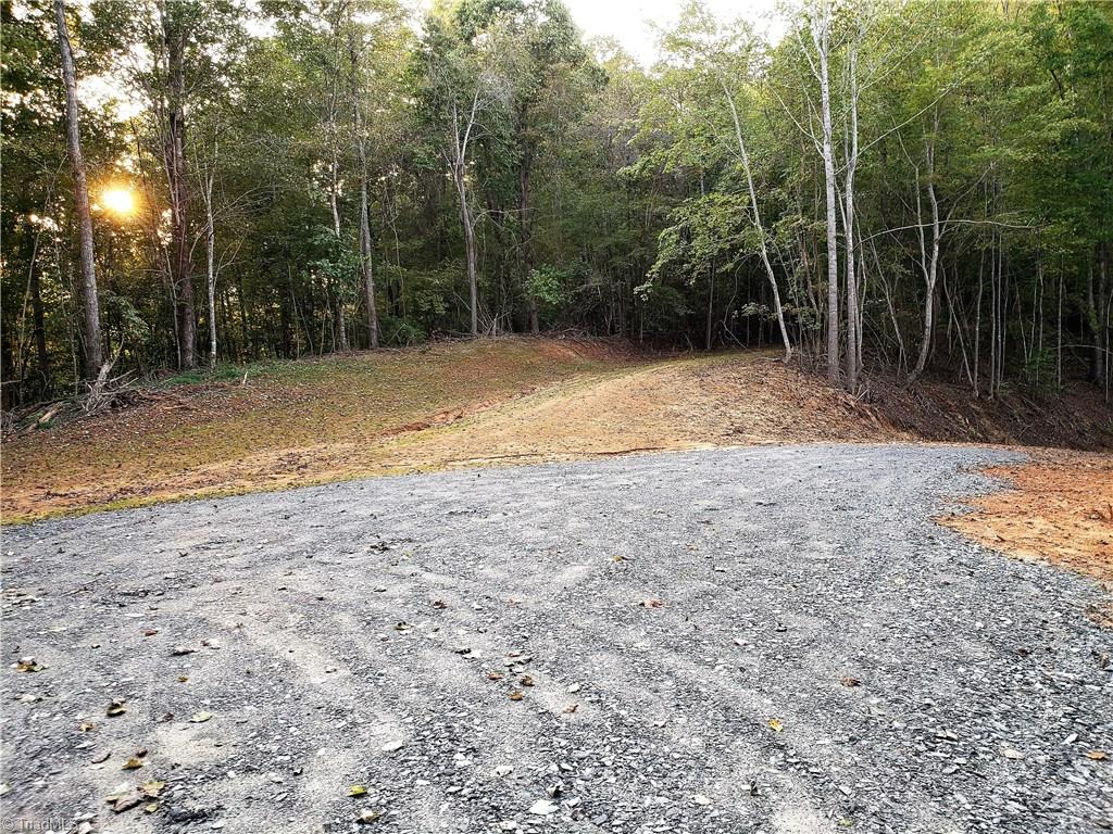 Large acreage tract with lots of road frontage. Property has a driveway already in place that leads to a beautiful, secluded building site. Located close to Dan River, Hanging Rock State Park, restaurants, stores, coffee shop, hospital, Stokes Art Council events, kayaking & hiking all in a country atmosphere! So many possibilities...single family home or profit from the kayakers & hikers with a campground or vacations cabins. Easily navigate the property by foot or enjoy riding your ATV's on the many, cleared road beds.