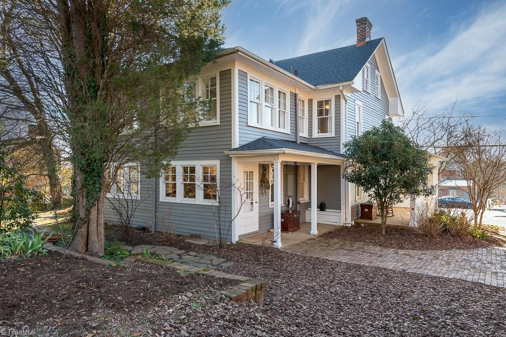 Welcome to this immaculate, preserved historic home in Old Salem. The Peter Fetter house, circa 1840, was built for the Moravian chairmaker and woodturner. Step foot inside this 2600+ sq. foot home, and take in the huge natural-light filled chef's kitchen with exposed brick. Abundant counter space with the kitchen opening onto two of four porches, perfect for indoor-outdoor living. Expansive garden spaces with established, historical plantings. Steps from the most scenic walkways of Old Salem and also easy walking distance to downtown. This home features incredible preservation with a classic updated design. Features such as clawfoot tubs, built-ins and 3 fireplaces. The attic with exposed beams is a perfect studio or hobby space. Recent updates include new roof, AC replaced, garbage disposal added, new dishwasher & new exterior paint. Many versatile spaces with options to work from home or to simply enjoy the restored beauty. Located in the heart of Winston-Salem. See agent remarks.