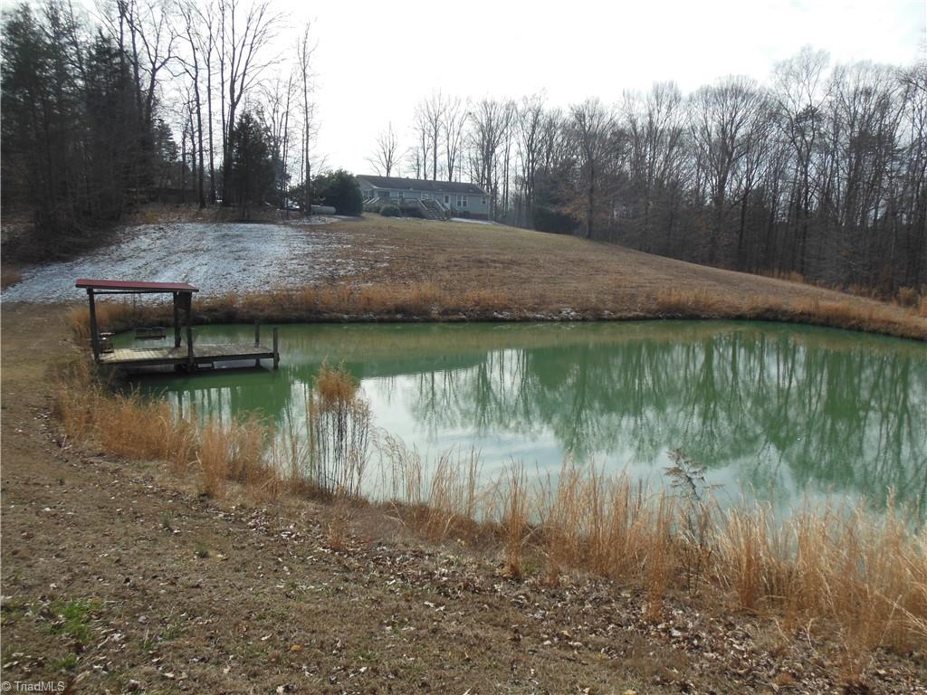 Rural and secluded, yet just minutes from Winston Salem, Kernersville and Walkertown. This 10 acre nature lovers paradise overlooks a stocked pond from the back deck. Partially wooded with some open fields perfect for horses or mini farm. Restored log barn that would be great for man cave or guest quarters. Convenient location adjacent to the new northern beltway.