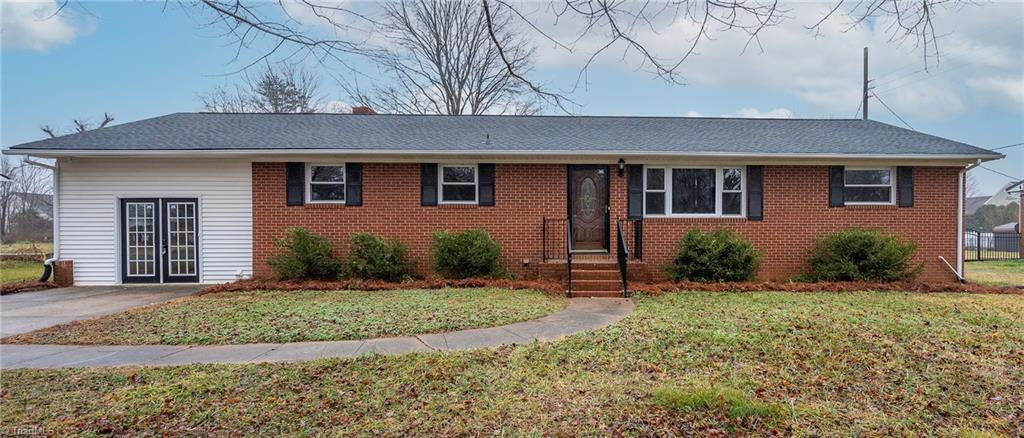 (NOTE: Back on market though no fault of Seller.) LOOKING FOR A HUGE, TOTALLY RENOVATED BRICK RANCH IN THAT AREA WHERE W-S, WALKERTOWN & KERNERSVILLE COME TOGETHER? WITH A FULL UNFINISHED BASEMENT WITH A FIREPLACE FOR POTENTIAL EXPANSION ROOM? AND UNDER 220K? THEN LOOK NO FURTHER! 3/2 with oversized primary BR with totally renovated adjoining bathroom & large walk-in closet. 3 oversized living areas...living room, den (with fireplace), great room (with fireplace). Combination kitchen/dining room with new flooring, granite & more. All flooring new (i.e., carpet, luxury vinyl & meticulously refinished wood floors in the living room & 2 of the BRs. New granite in bathrooms. Smooth, sensible layout. New laundry closet added upstairs to move laundry to main from basement. Full unfinished basement w/fireplace, can be accessed from inside or backyard with covered entrance. New roof. Large lot. NOTE: Picture window in living room is being replaced; on order. Pls remove shoes...all new floors.