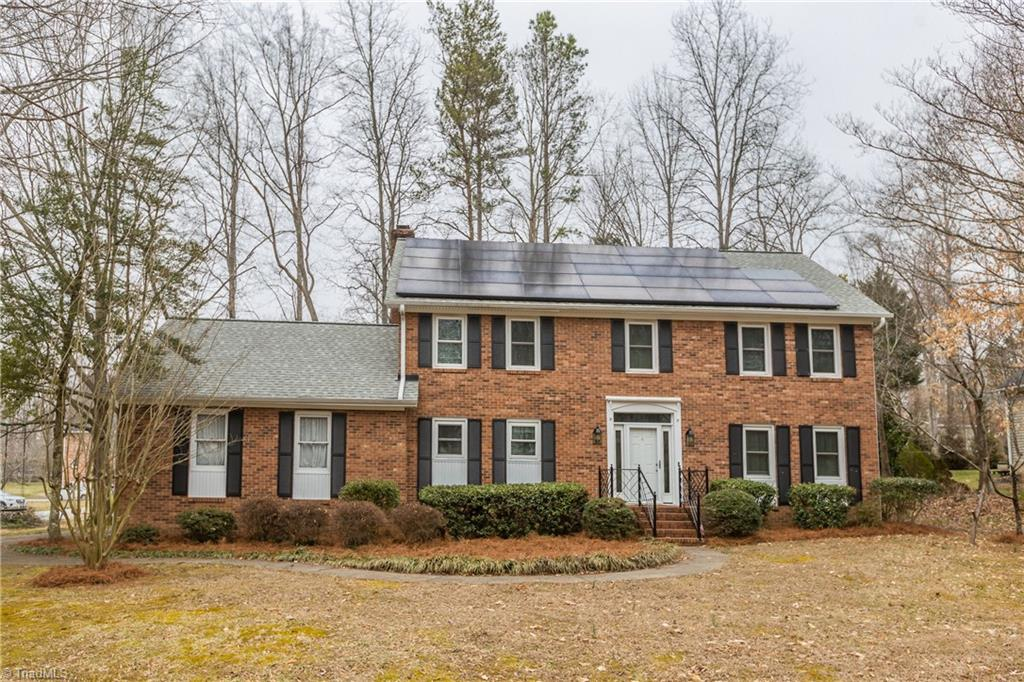 Come Home to this awesome 2-story brick traditional home on a nice, wooded corner lot. Great neighborhood and neighbors! Large entry. Den w/blt-ins & FP. Formal living & dining rooms with wainscotting. Large kitchen w/island & breakfast bay. Huge master suite w/his/her closets, garden tub/separate shower. Perm steps to unfinished attic. Main level garage. Water purification system. Solar Panels for energy efficiency. New appliances. 2-10 Home Warranty offered. Don't miss your dream home!