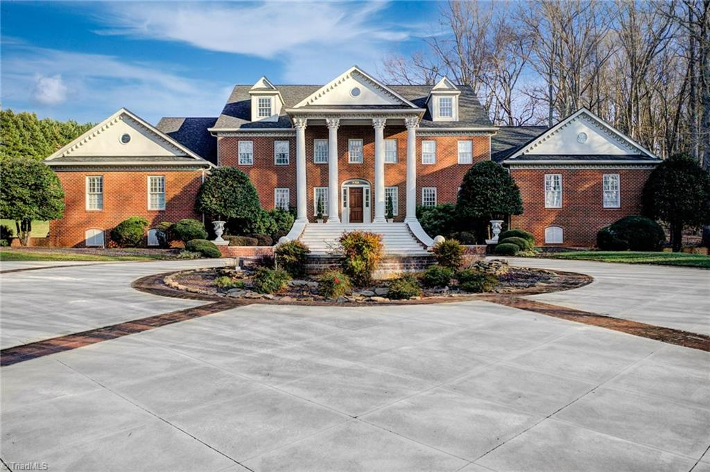 Stunning estate resting on nearly 4 acres, this is one of Winston Salem's most extraordinary properties. Features include: Gorgeous kitchen w/ granite & top of the line appliances; ML master bedroom w/ his & hers bathrooms; 6 bedrooms, each w/ full bathrooms featuring custom Italian tile; Reclaimed hardwood floors; Expansive gym & theater; Wine cellar; Ample outdoor entertaining space; & more. This entertainers' paradise has been thoughtfully updated & no detail was overlooked.