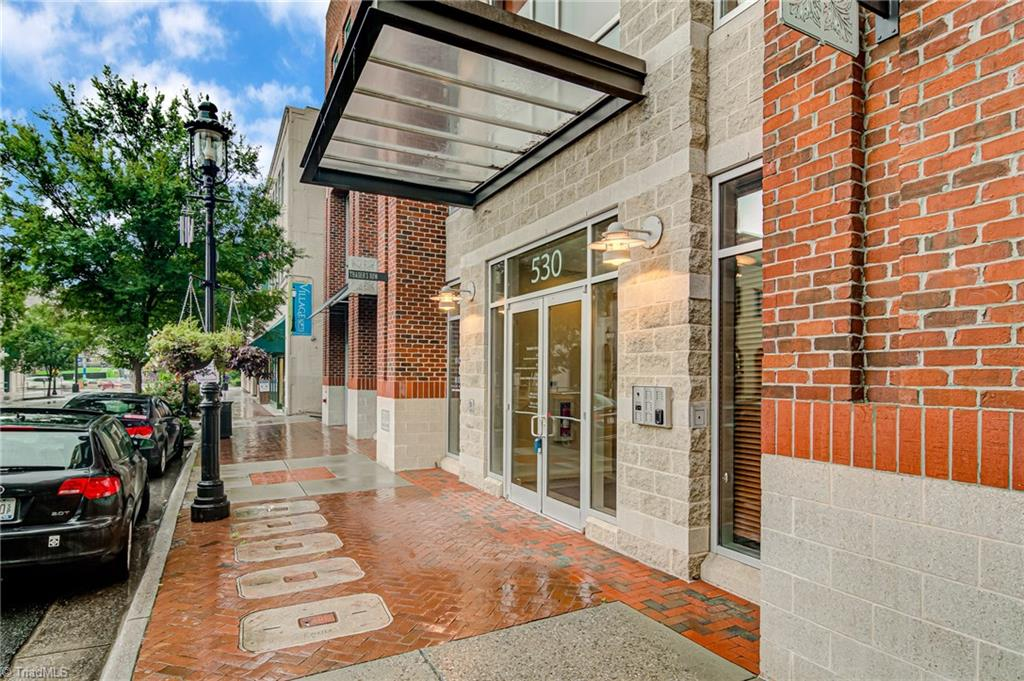 """Enjoy the city skyline & views of pilot mountain from this sophisticated corner condo located in of heart of the Arts District. Trader's Row is one of DTWS's most exclusive addresses & AIA NC """"Merit Award-Urban Design"""" recipient with superb construction. Spacious unit includes recent updates such as Stone fireplace with built-ins and contemporary gas logs, Master Bath tiled shower with unique niches, new kitchen counters, space flexibility with """"Murphy"""" bed in guest room. 2 Parking spaces with easy access to guest parking."""