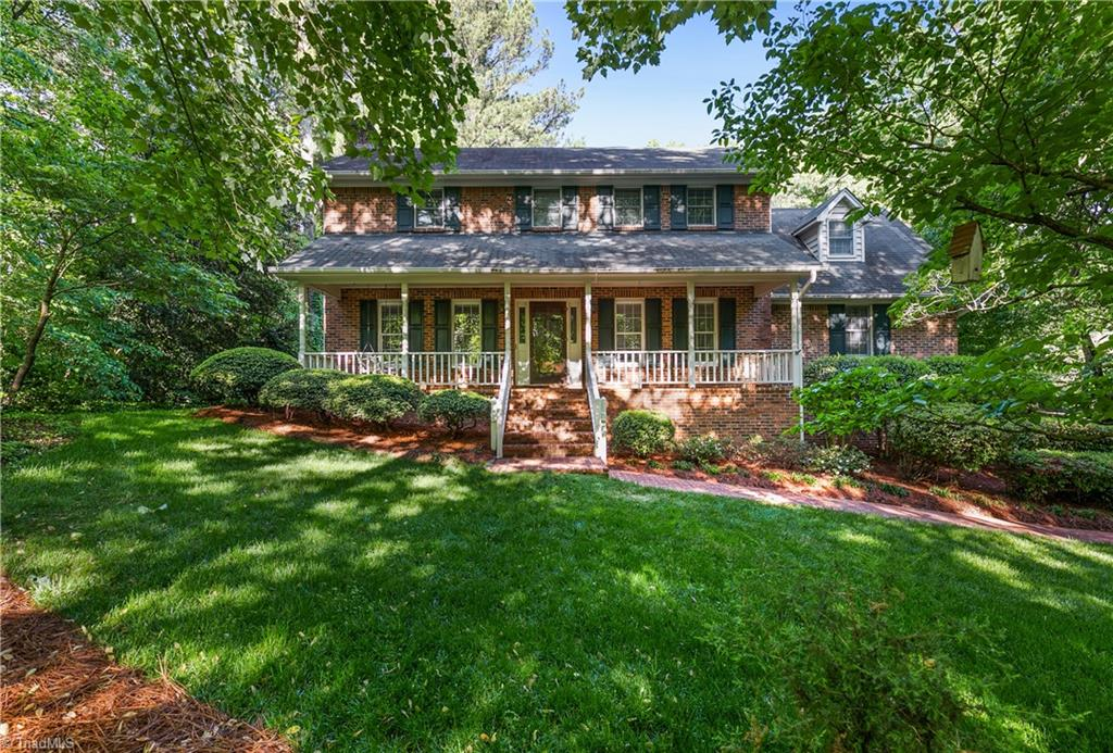 A welcoming Rocking Chair front porch with brick walkway greets you.  This home has a large great room with a cozy fireplace, ML Laundry room and ML Bedroom with ensuite bath.  The dining room has beautiful view of the private backyard with a bay window.  The kitchen has an oversized island for easy prep of meals. The screened porch and deck overlook a wooded backyard full of azaleas. The UL has a huge primary suite plus two more bedrooms.  One bedroom could be used as a bonus room.  The lower level has a full kitchen, fireplace, and full  bath that could easily be an in-law suite.  The oversized Two car bsmt garage is great for a workshop or storage. Two new heat pumps. This home is located in a popular neighborhood surrounded by larger homes, close to shopping, great schools and easy access to the highways.  This one awaits your special touch.