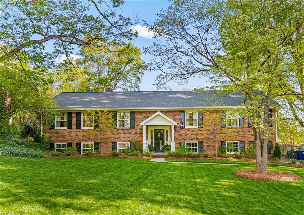 Meticulously landscaped & red brick home in timeless Old Sherwood Forest. Hardwoods throughout the upper-level w/ tile in kitchen & bathrooms. Multiple gracious living spaces. French doors from den open to oversized deck, perfect for entertaining and overlooks a flat and maturely landscaped yard for all to enjoy. Fabulous office on lower level which could be 4th bedroom. Highlights: Portico '20, Water Heater '20, Heat pump/Furnace/HVAC '19, Interior paint '17 w/ updates in '20 & '21 & DIY master bath'20. Walk to Sherwood Forest Elementary & quick access to hospitals, shopping & WFU.