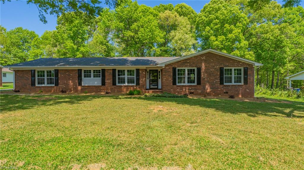 This newly renovated, open concept house is located near great shopping and restaurants in Winston-Salem! Brand new roofing, windows, electrical systems, exterior doors, and siding. The kitchen has granite countertops and stainless steel appliances. Bathtubs, fixtures, and HVAC have also been recently replaced! This beautiful brick home will not last long!