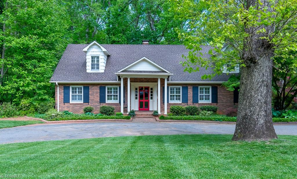 """Classic Cape Cod home on one of the prettiest streets in Sherwood Forest. Step from the welcoming entry into a spacious living room (fireplace is decorative) and stunning dining room. Kitchen has adjacent enclosed porch/mudroom  and side door for easy package/grocery delivery. Bright breakfast area with vaulted ceiling and skylights overlooks the backyard.  Cozy den has fireplace with gas logs and double French doors that open to a delightful screened porch.   Primary bedroom plus second bedroom and additional full bathroom on main level. Three spacious bedrooms upstairs. Finished basement offers generous space for playroom and office/exercise/additional bedroom; kitchenette and full bathroom, too. Basement fireplace (not used by current owners) and backyard shed """"as is"""". Great storage in unfinished portion of basement."""