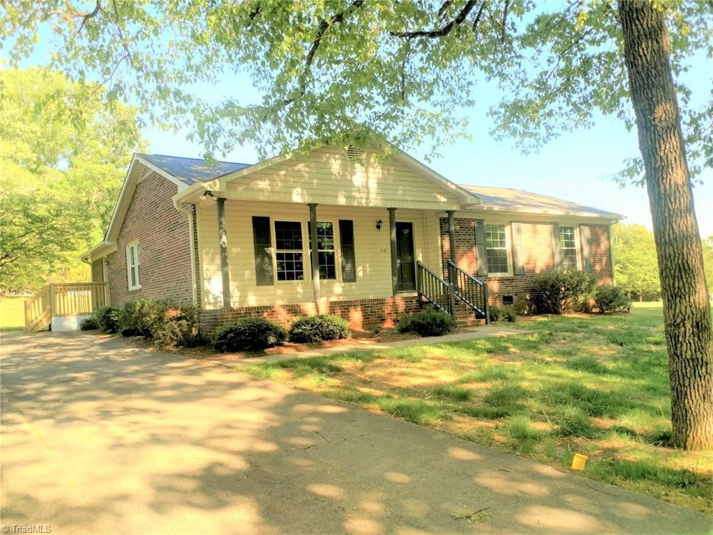 Updated home Like new, New paint and flooring, Quartz counter tops, Tile showers, Vinyl plank flooring, Stainless appliances, insulated windows, and all of this comes with a 1 year warranty.