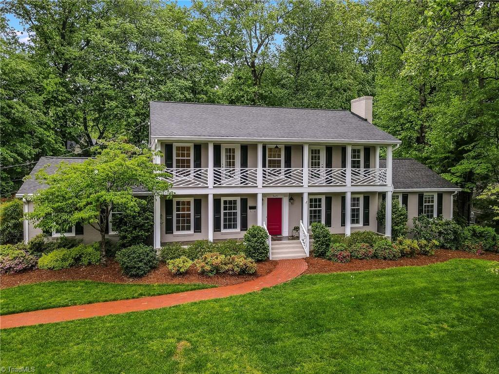 Stunning all-brick home in desirable Sherwood Forest! Main level features an expansive Kitchen with granite countertops, gas range & double oven.Gracious dining room with wainscoting. Large living room with charming mouldings & fireplace.Separate den with a fireplace makes a perfect home office or music room.Convenient main level guest suite with cedar closet.Upstairs owner's suite with a large walk in closet, bath with tiled shower & heated floors.Three roomy upstairs secondary bedrooms.Finished basement with an additional bedroom provides plenty of space for hobbies or storage.Walk out screened porch makes entertaining a breeze and rainy days still fun. Professional landscaping with patio/firepit & yard irrigation system.Main level two car garage right off the kitchen makes groceries a cinch to unload.Easy access to downtown & adjacent to the par course.This one's a gem!
