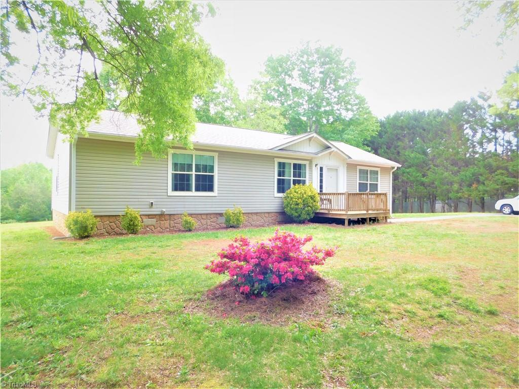 3 bedroom/2 bath home on 6 acres not far from 421. 24x12 outbuilding wired but not connected. New roof in 2018 and new heat pump in 2017. New vinyl plank just installed in living and dining area. Stainless and black appliances. Washer and Dryer convey. All bedrooms are good size with large closets. Split floorplan for privacy. Primary bath has double sink, soaker tub and separate shower. This one won't last long.