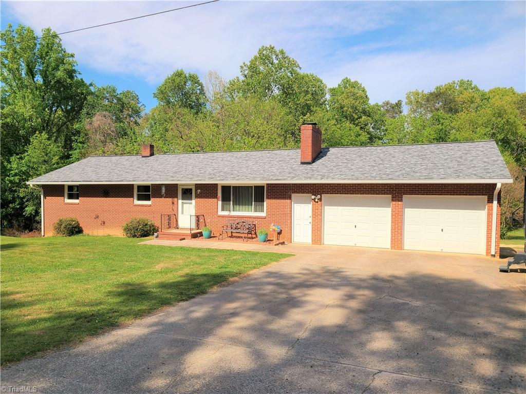 Nicely updated brick ranch with basement on over 1 acre.   Home has insulated windows and doors, within the past year new roof and gutters, Heat pump in 2015, updated wiring and plumbing, basement water proofed by Tarheel basements and new garage doors!  Also on the property is a 36x30 commercial grade shop with a 200 amp box and 3 phase power.  This one has it all and needs nothing, great location convenient yet out of the neighborhood!