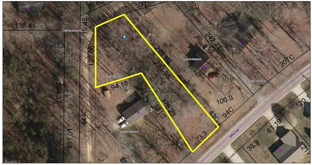 Wooded lot with 73 ft road frontage - opens in back.