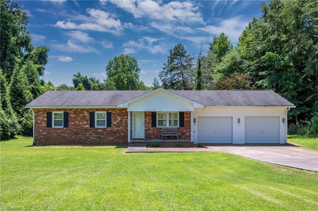 """What a GEM! One level living in Davie County at its finest! Well maintained BRICK RANCH w/ 3 bedrooms & 2 baths, extra large 2 car garage. 100% move-in ready for its new owner to enjoy. Back deck for lounge or grilling  Bright, sunny kitchen w/ ISLAND. COUNTRY SETTING on large .62 ac lot, Low traffic, paved road that dead ends. Enjoy PRIVACY w/ low taxes and exceptional schools. This home has NEW 2018 WELL, 2017 NEW HEAT PUMP w/ backup propane heat available. This could be """"the one"""" for you, come see for yourself! Just minutes to I-40, restaurants and shopping."""