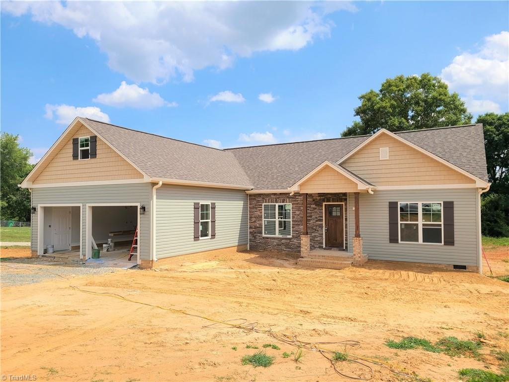 New home on over 1 acre in Tobaccoville!  Home has 3 bedroom/2 bath with 9 foot ceilings, Granite counter tops, hardwood flooring in living areas, tile in bathrooms, Great room built ins, oversized garage, screened in porch on back, rounded corners throughout the house, and all of this outside of the city limits!  Beautiful home almost finished.