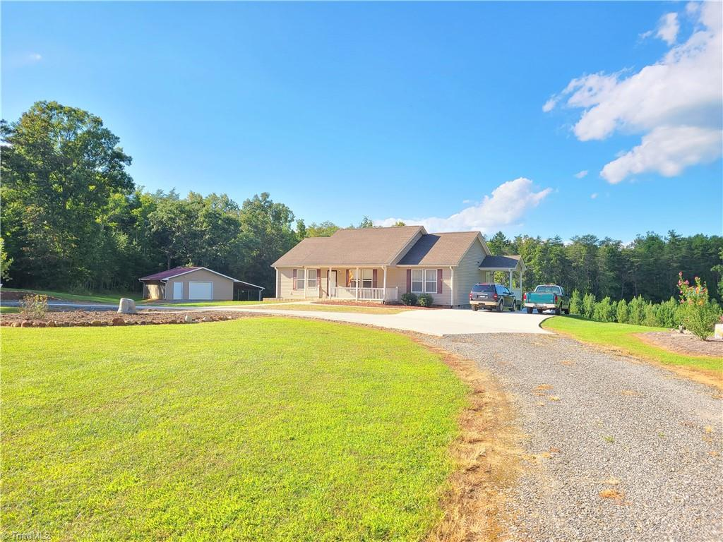 Highest and best due by 7pm Monday 9/13. Privacy, convenience and over 5 acres!  Great location on Matthews road in Pilot Mountain with a little bit of everything.  Property boasts privacy, well maintained 3 bed/2 bath home with vinyl plank throughout, split floor plan with separate laundry,  Generac 20kw whole house generator, Trex decking on both decks including covered deck on rear, 36x27 workshop with covered shelter off the back, beautifully landscaped and a spring on the back of the property perfect to make your own pond.  Home is move in ready and is a rare find in Pilot Mountain.