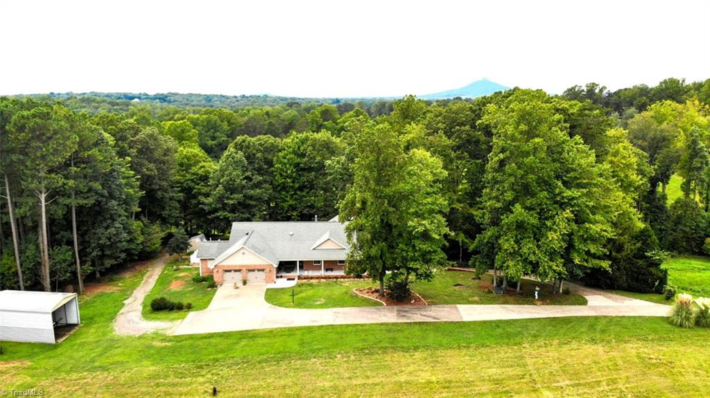 Didn't think a place like this was possible...here it is! 23 acre estate in King with pool and stocked pond! Stunning custom built, brick home sitting privately off the road. Offering 4 Br's, 3 Ba's with room to spare for every family member or friend coming for the holidays! Enjoy the country living feel just minutes from all your needed conveniences. Open living/dining area with an abundance of illuminating windows. Large kitchen, living room w/ fireplace, black walnut wood flooring, spacious master bedroom w/ deck overlooking the sparkling, blue pool, full basement w/ finished guest quarters only add to this exemplary home. Relax by the pool, paddle boat or fish at the spring fed pond!  Oh and don't forget to bring the animals! This property is horse equipped with fenced pasture, run-in, hay/equipment shelters, 5 stall livestock barn, tack room and water access. Privacy, a spectacular home, ample living space, room to adventure, relax, play and convenience!