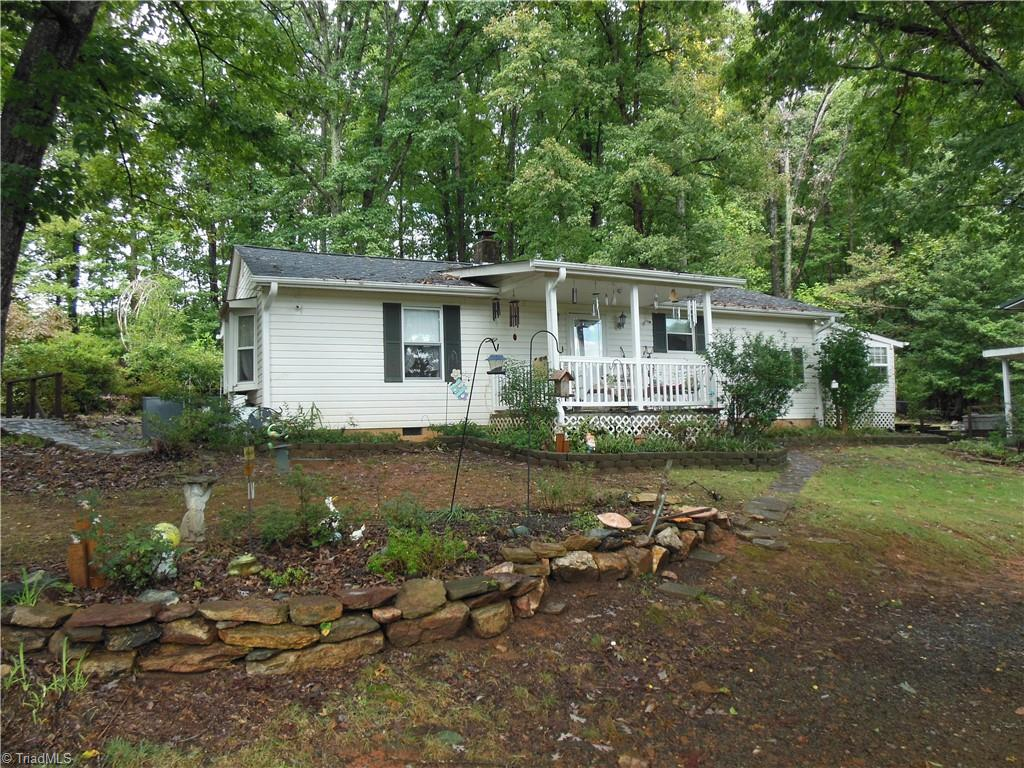 Cozy cottage on quite dead end street. 2 bay detached metal garage with smaller roll up door for mowers etc.  Nicely wooded tract. Roof covered 2019. Hot water heater replaced 2021. Heat pump approximately 4 years old. Convenient location just 30 minutes north of Winston Salem. Close to Danbury, Hanging Rock State Park and the Dan River.