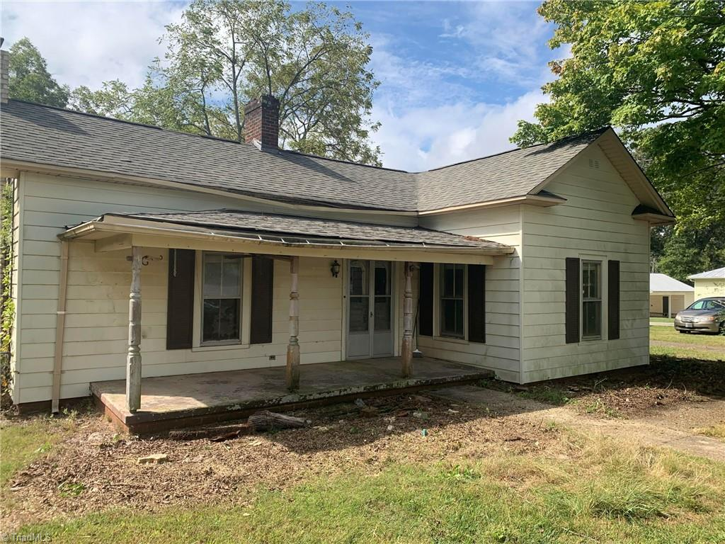 """Fixer Upper in great downtown King location on approx. half acre lot. Selling """"AS IS""""."""