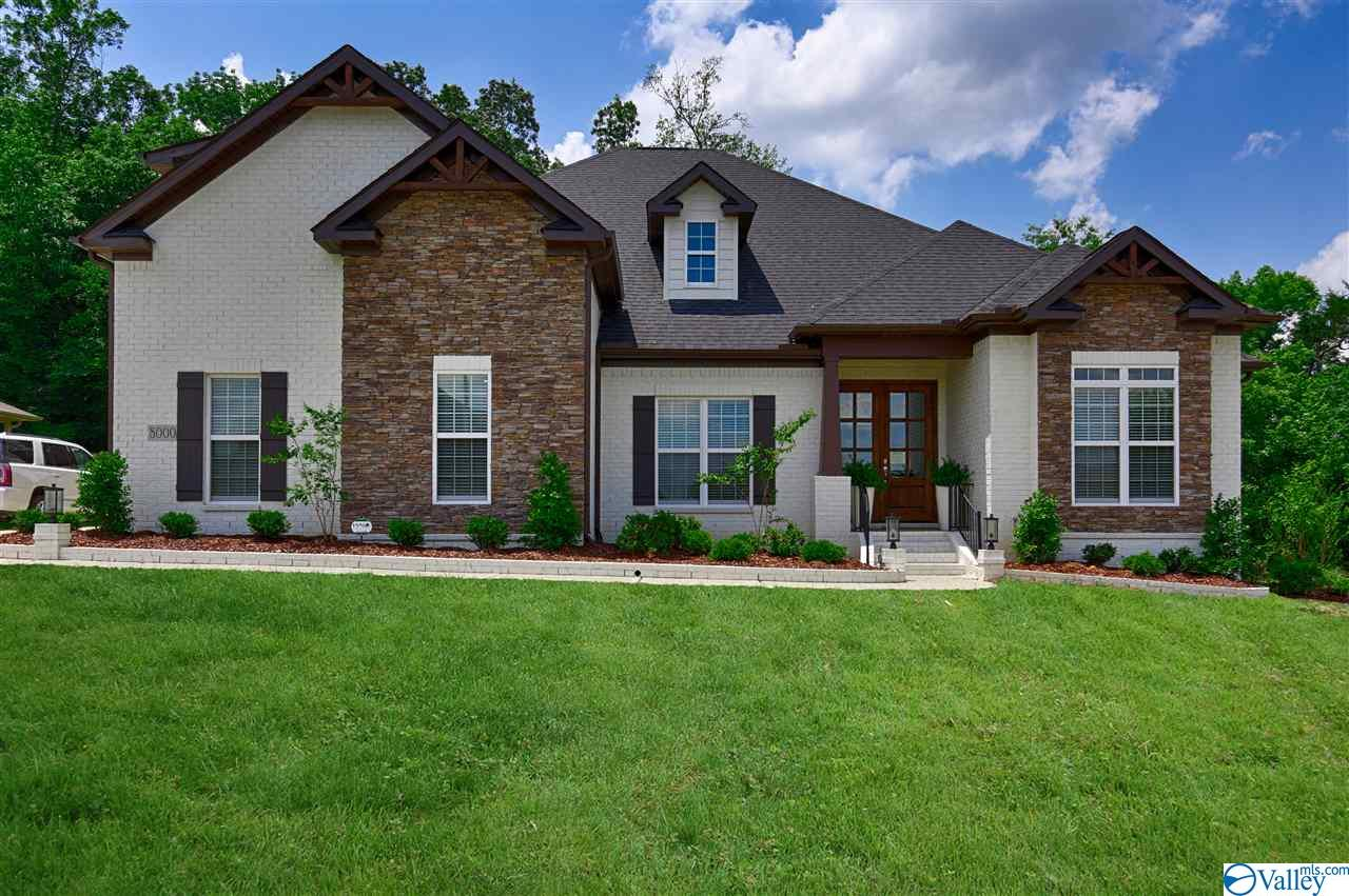 Photo of home for sale at 8000 Goose Ridge Drive, Owens Cross Roads AL