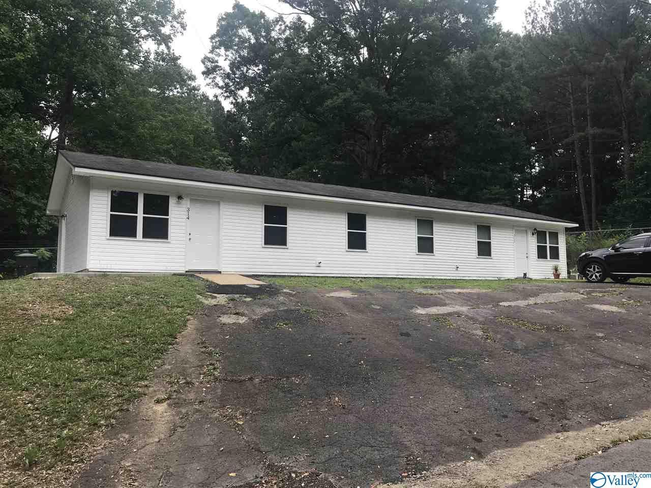 Photo of home for sale at 312  // 314 Sebring Street, Scottsboro AL