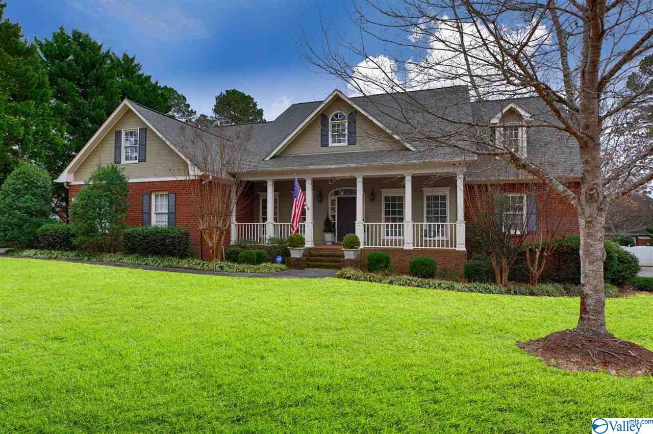 Southern Living at its best, 5BR/4BA home in beautiful Hampton Cove! Gorgeous fixtures, hardwoods, granite, built-ins, Amazing two story ceiling in great room w/Chippendale banister! Great RM leads to an incredible kitchen w/gas cooktop, Breakfast & Keeping RM w/built-in desk. Isolated master w/his & her master closets + 2 added bedrooms on main level. 2 large bedrooms upstairs + Study/Office area & Huge Rec/Bonus room w/space to enjoy a pool table, TV + flex space. Abundance of walk-in attic storage, Spacious/Private yard w/covered patio + extended patio, gas lines for outdoor grill. Storage/Workshop around back of house w/concrete flooring & utilities. Hampton House membership Included.