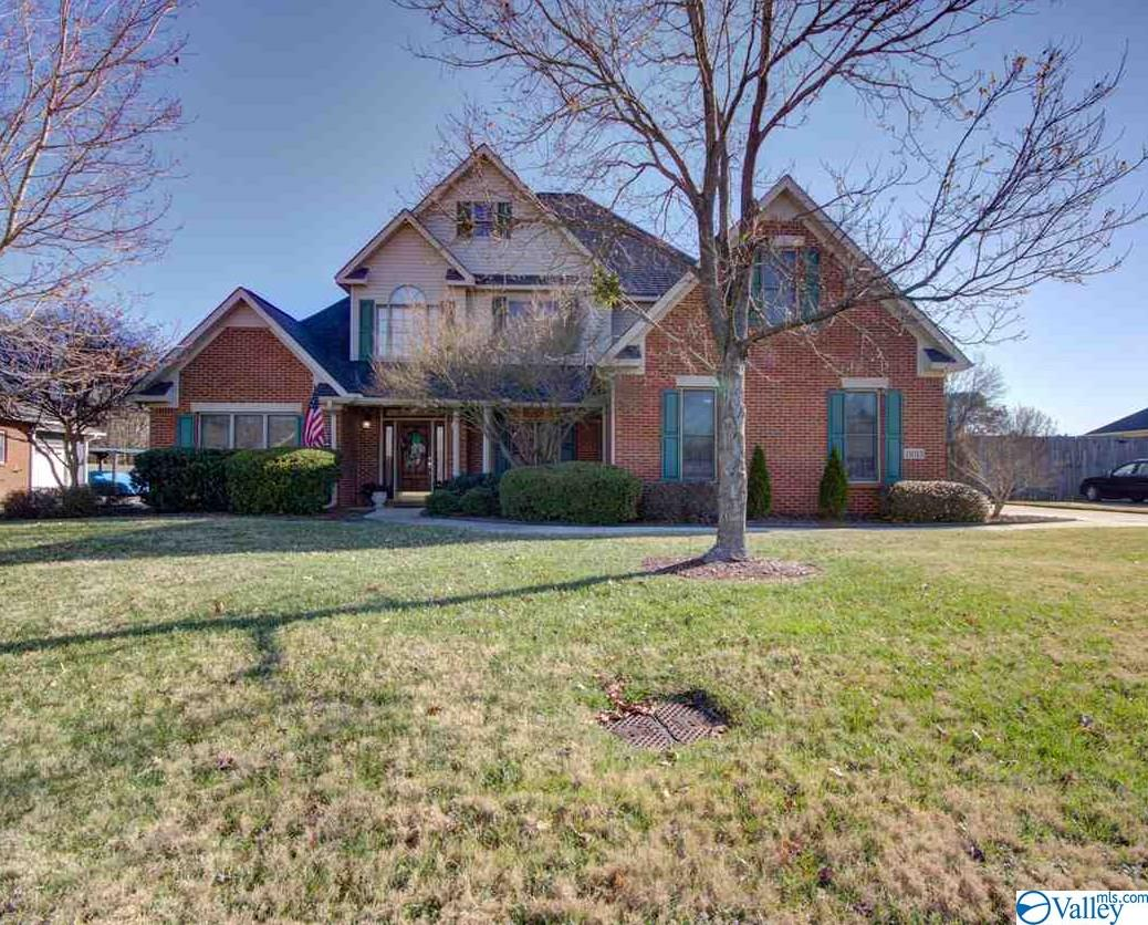 Beautiful custom built one owner home in desirable English Village. Professionally landscaped yard welcomes you to an inviting front porch. Entryway and den has soaring ceilings. Gorgeous hardwood floors throughout main living area. Tiled wet areas. Main floor master with 3 additional bedrooms upstairs. Bonus room upstairs can be used as an additional bedroom. Carpeted upstairs.  Lots of closets and storage space. Jack and Jill bath upstairs has separate vanities and toilets. Home has a sprinkler system as well as an underground pet fence. Enjoy listening to surround sound in family room by the gas fireplace or outside on covered patio.TV connections in laundry & kitchen