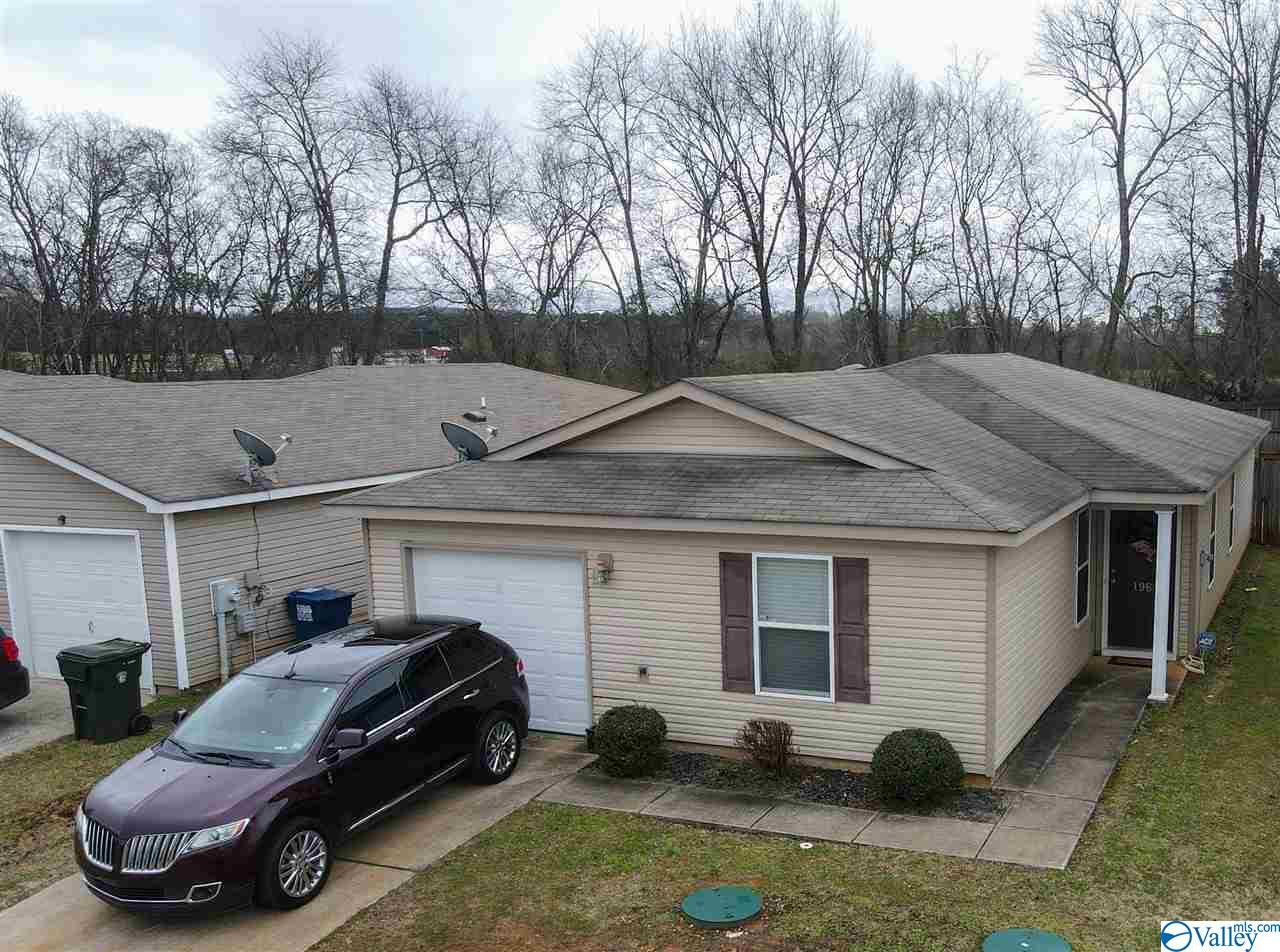 Home has an open floor plan. Large isolated master with a walk-in closet. Kitchen has an island. The backyard has a fence. Well maintained home. Single owner home. This property is close to shopping; very close to Hwy 53, short commute to Huntsville and Tennessee.
