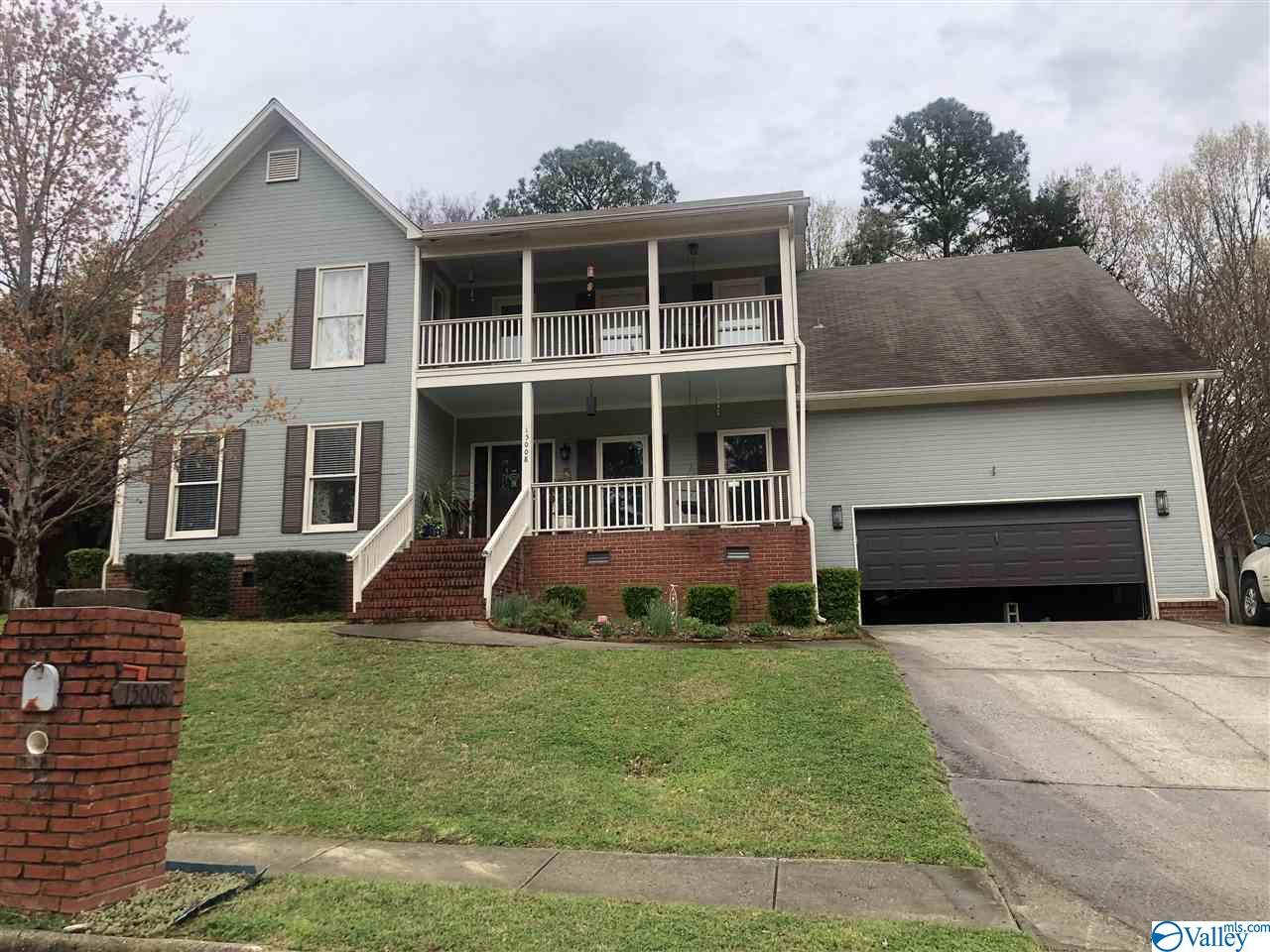 LARGE 5BR, 2.5BA FAMILY HOME in South Hsv!! over 3700 SF home with large family room with hardwoods and fireplace, formal living and dining rooms also with wood floors, eat in kitchen with granite counters, covered front porch, balcony at second level, plus screened deck, and sun deck to enjoy the private, treed back yard with privacy fence, master suite is huge and has glamour bath and walk in closet, 4 additional bedrooms are also spacious, 5th BR could serve as a large bonus room, 2 car garage, do not miss out on this one!!