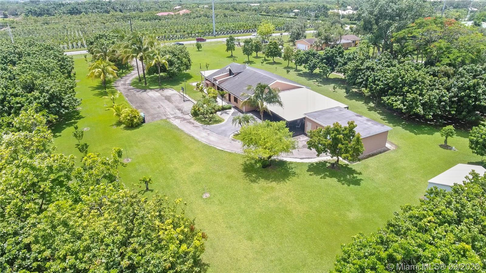 almost 6 acres with home, det. garage/workshop, 9 car carport and income longans on a main road,