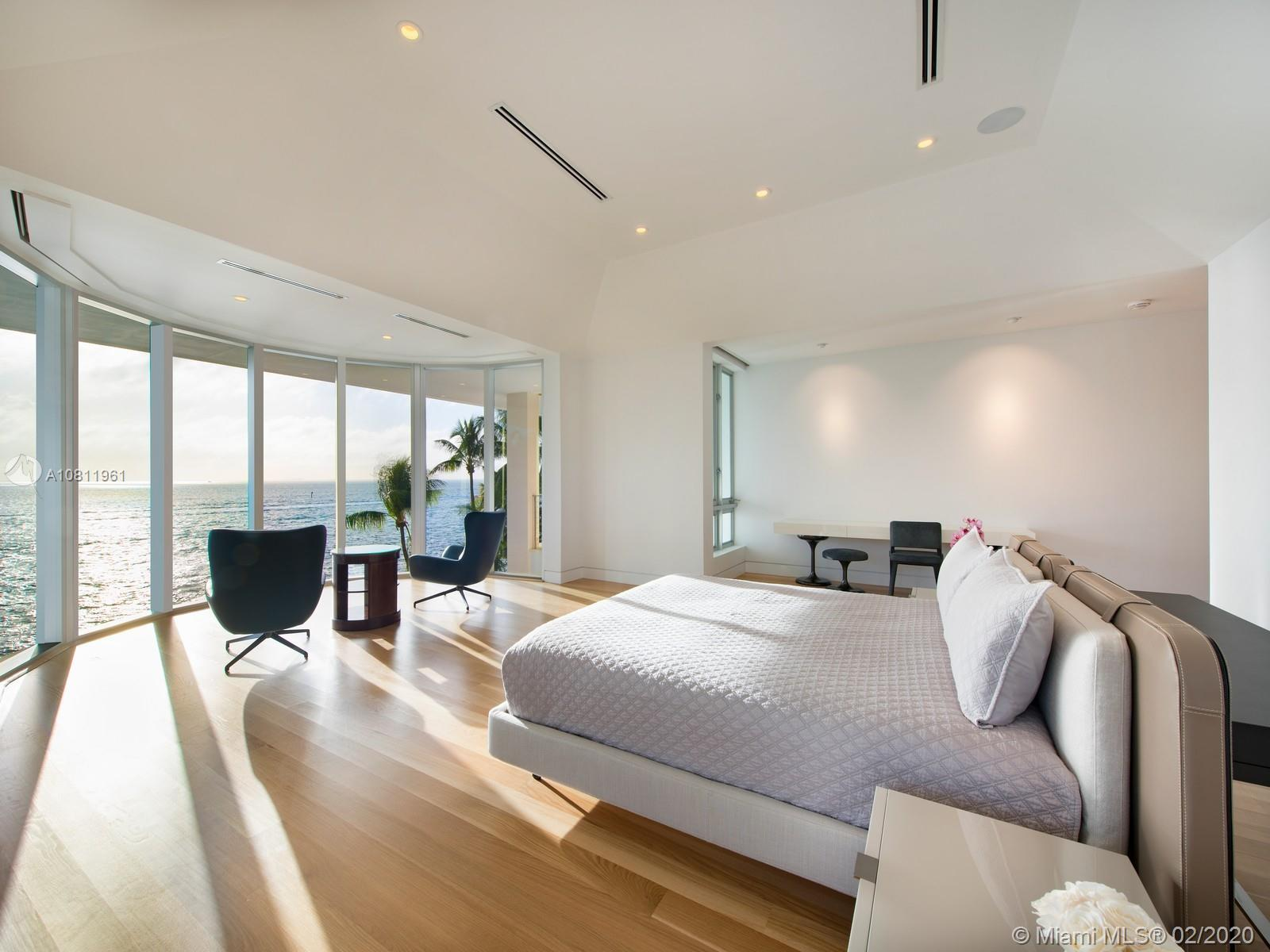 Master bedroom featuring 11-ft ceilings, white oak floors and direct ocean views.