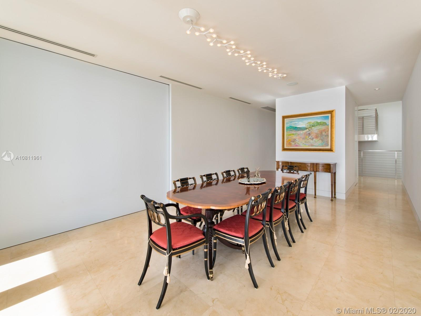 Dining room featuring Artemide lighting and direct ocean views.