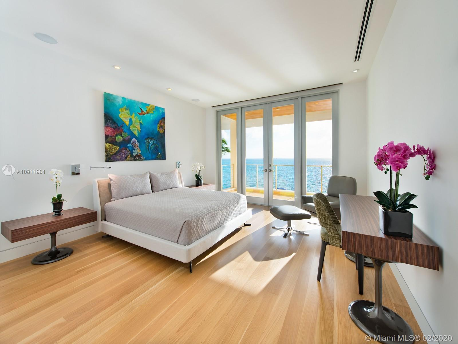 Third floor bedroom with outdoor terrace and direct ocean views.
