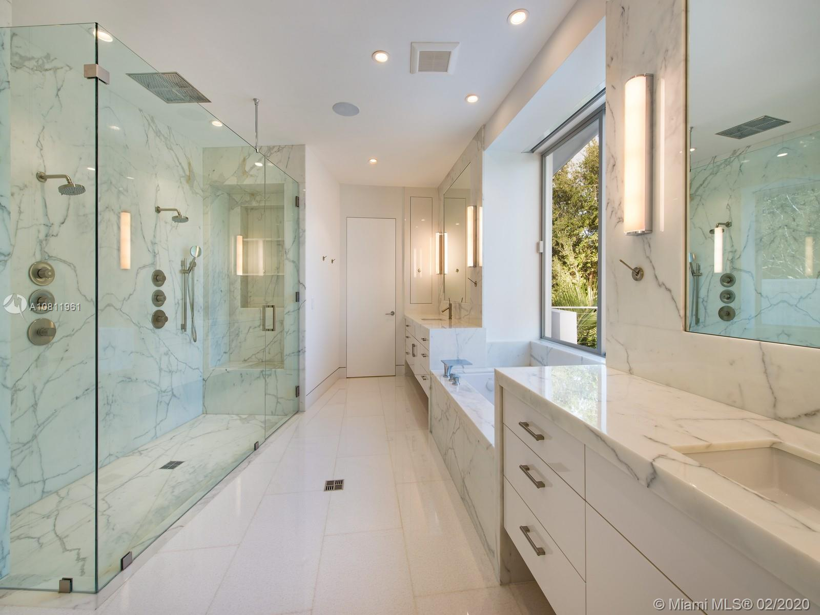 Master bedroom bathroom features calacatta gold marble and Hansgrohe fixtures.
