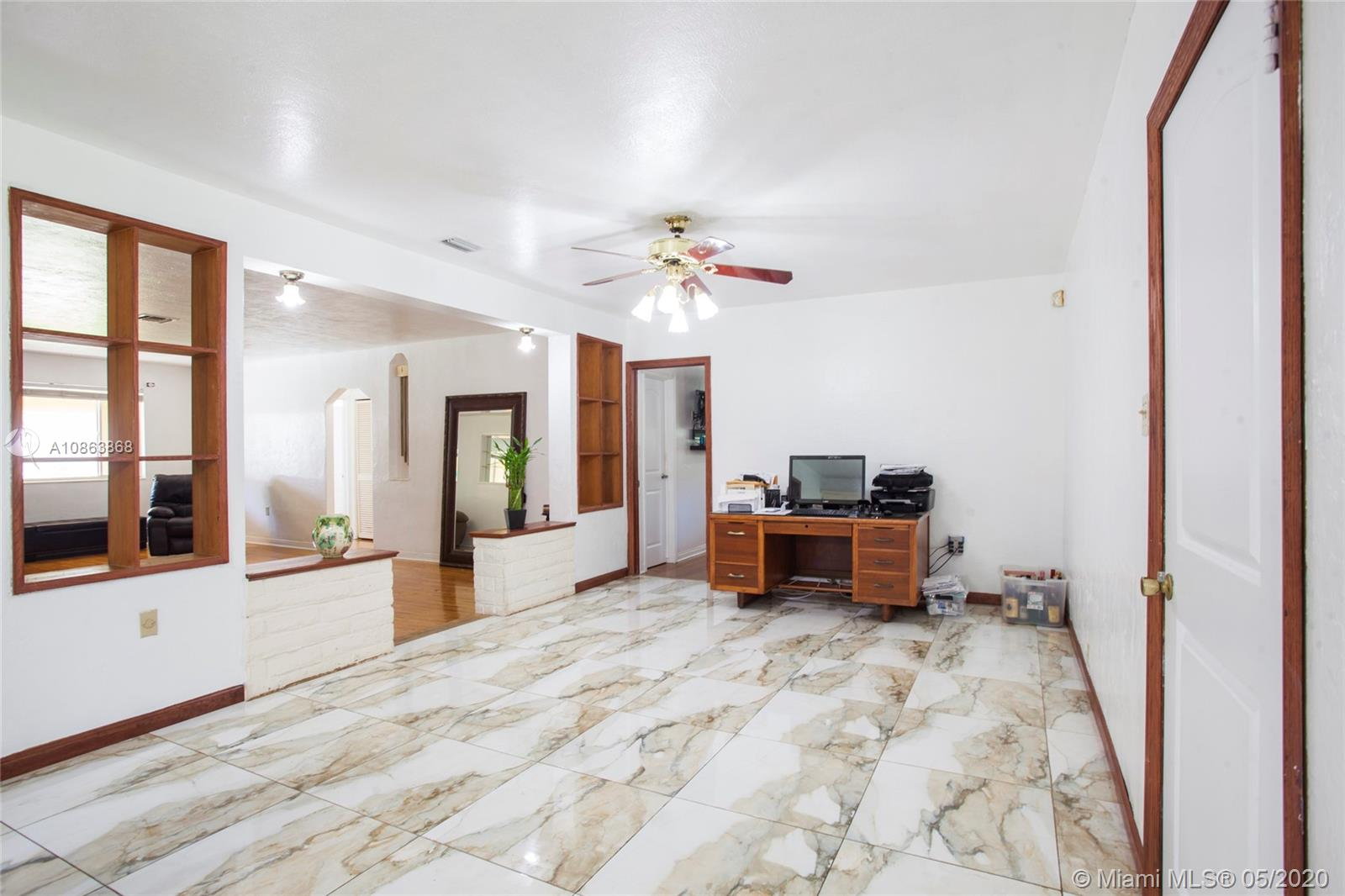 Photo of 10642 NE 10th Ct # listing for Sale