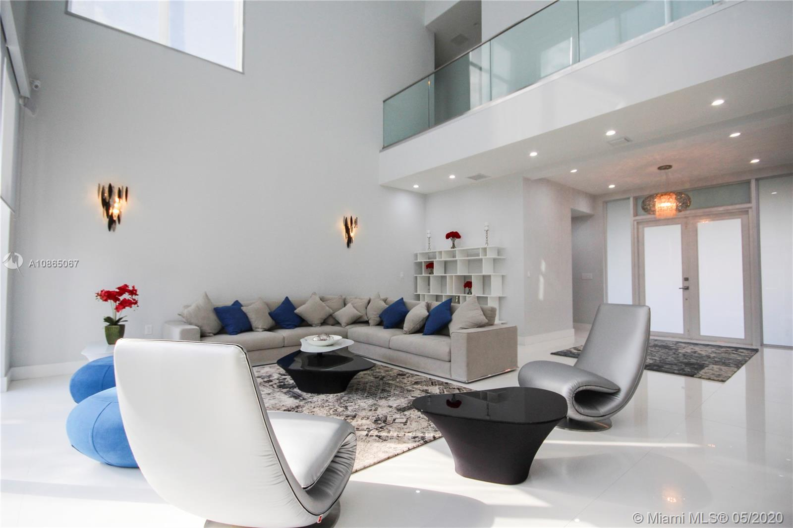 Spacious living room with 28' Ft high ceilings.