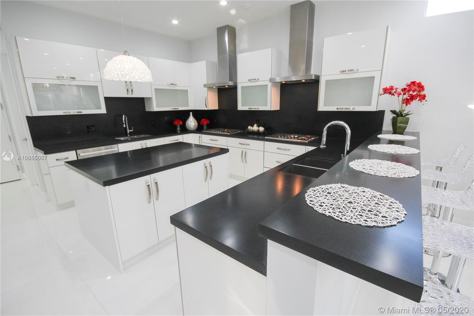 Gourmet kitchen with double range, double sinks, double ovens.