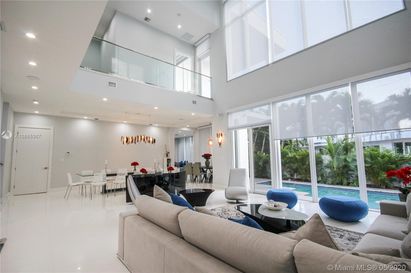 Floor to ceiling windows providing natural light throughout.